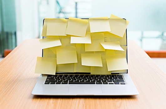 Laptop screen covered by adhesive notes