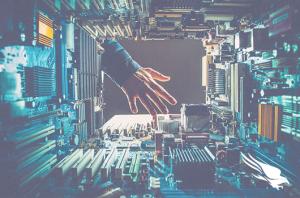 hacker hand inside computer hardware