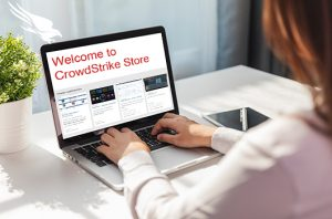 woman looking at crowdstrike store page on laptop