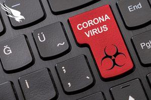 keyboard with red coronavirus button