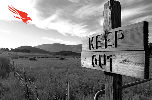 Wooden Keep Out Sign In Grasslands