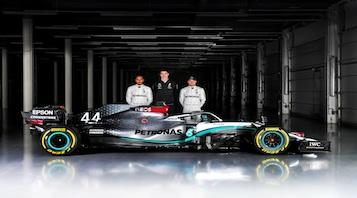 mercedes f1 team standing behind 2020 car