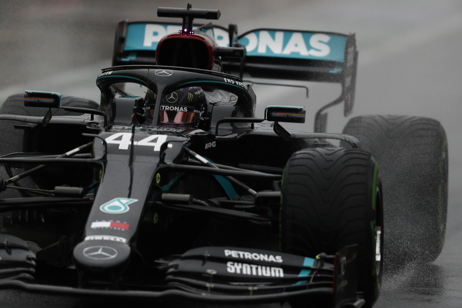 mercedes amg petronas f1 car driving on wet track