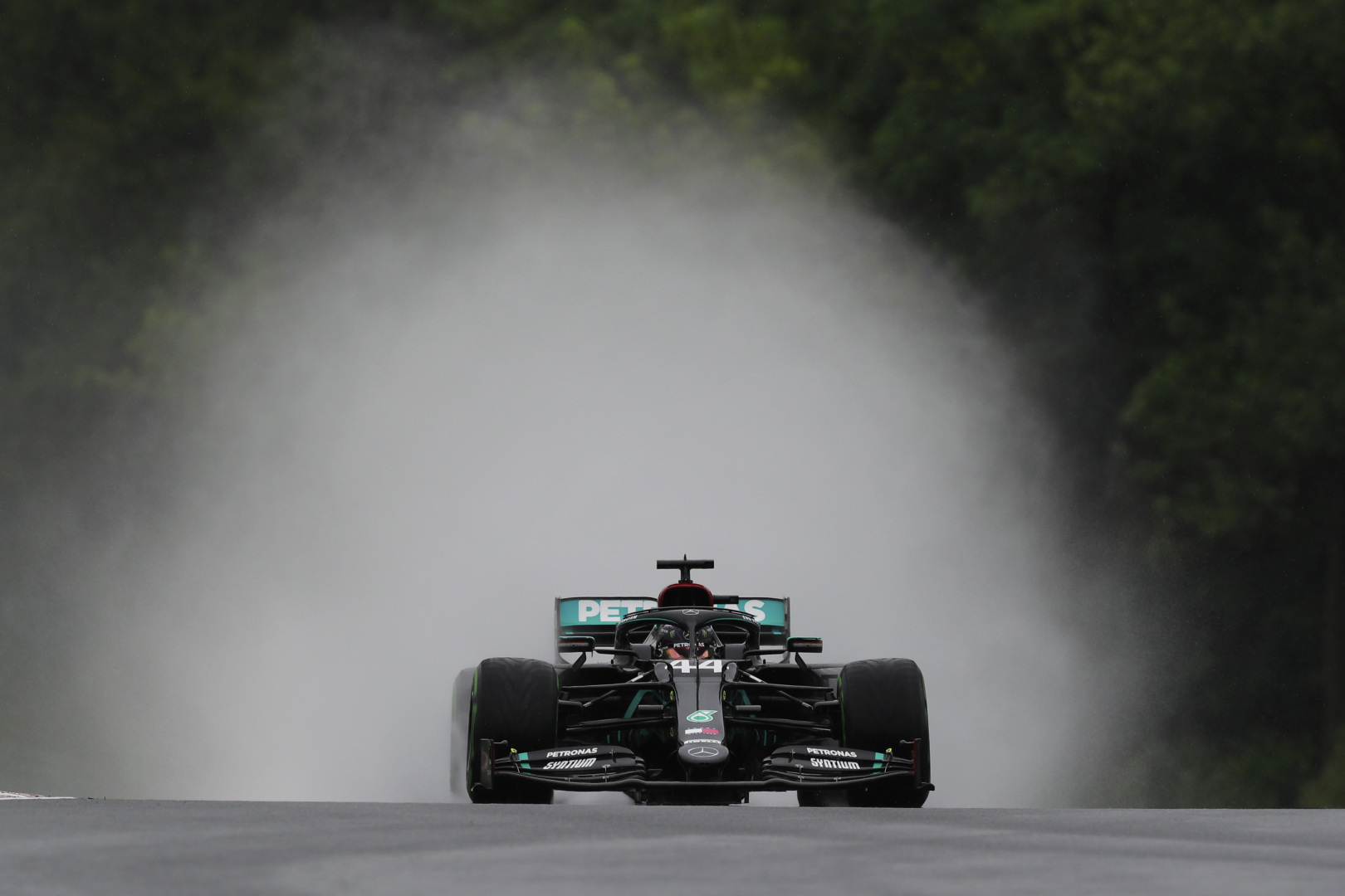 mercedes amg petronas car driving in cloud of smoke